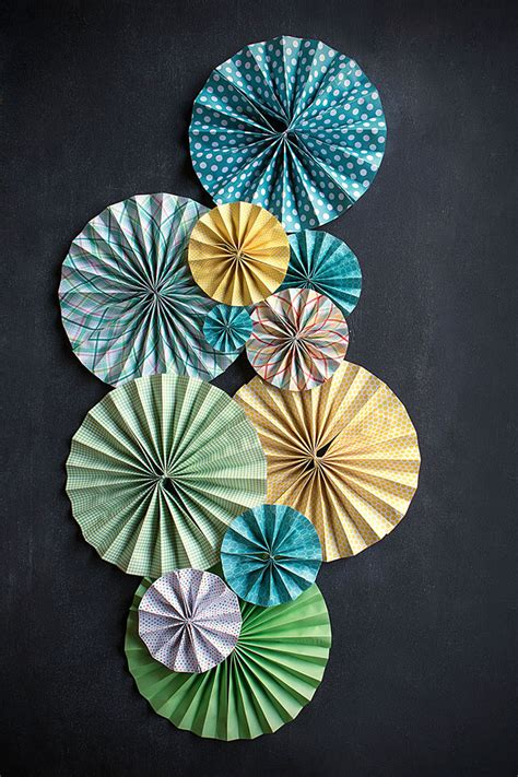 how to hang paper fans on wall diy paper fans weddings ideas from evermine