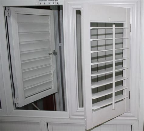 outward plantation shutter windows  protect  house buy plantation shutterplantation