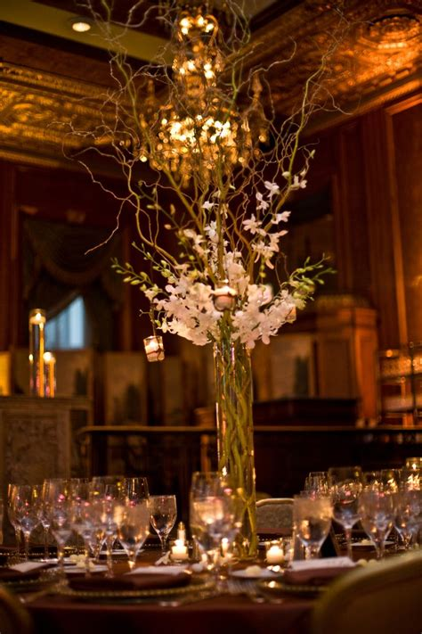 tall curly willow  dendrobium orchid centerpiece