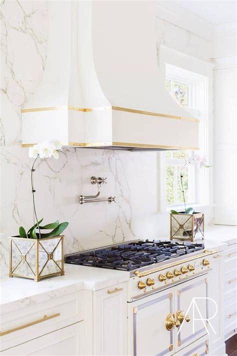 White Kitchen Gold Eye by Alyssa Rosenheck White And Gold Kitchen With