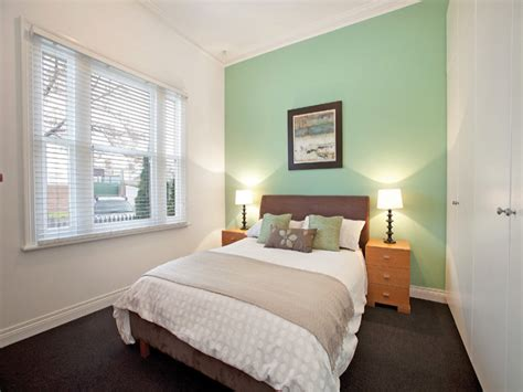 green feature wall ideas classic bedroom design idea with carpet built in wardrobe using green colours bedroom photo