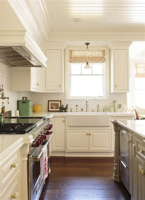 white kitchen  gray island fitted  gold hardware