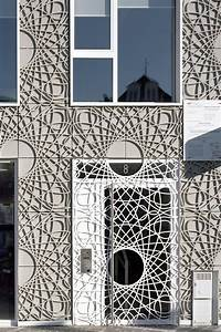 This building facade is covered in decorative panels made ...