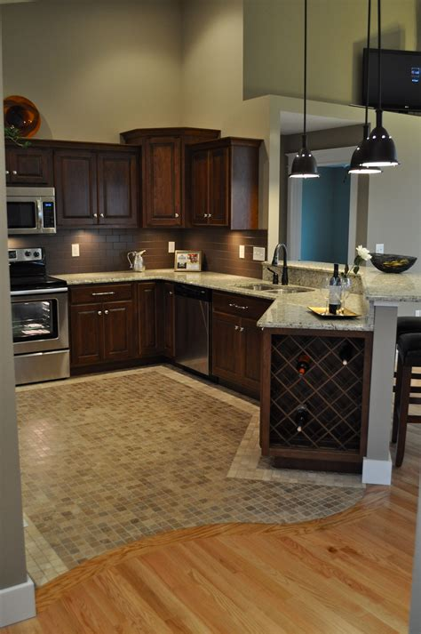 wood tile in kitchen oak hardwood floors with curved transition to mosaic 1608