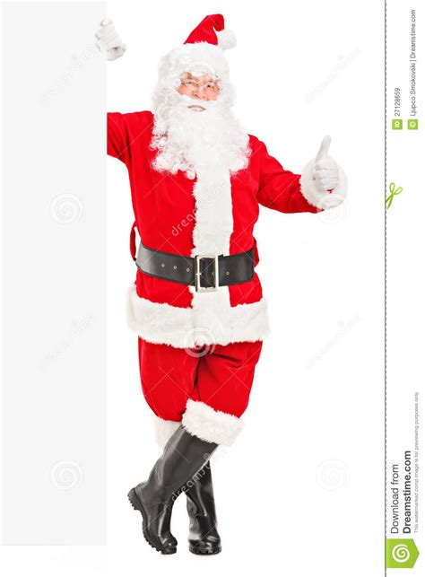happy santa claus standing next to a billboard stock image