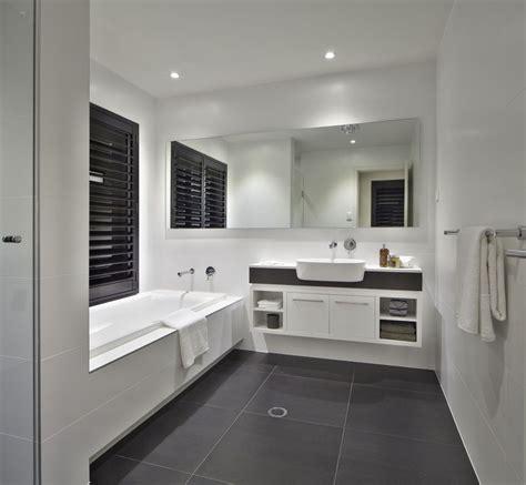 white bathroom  charcoal floor tiles  caesarstone