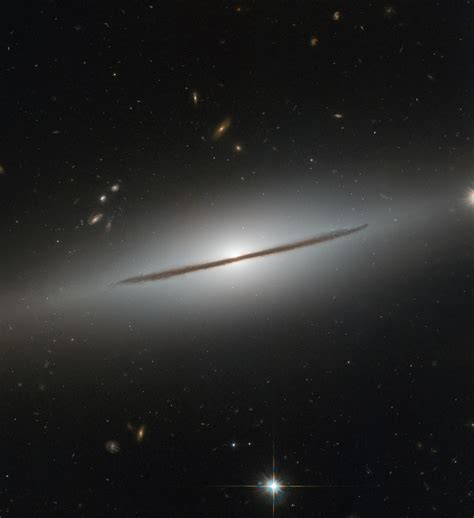 Hubble Catches A Spiral Galaxy In Disguise