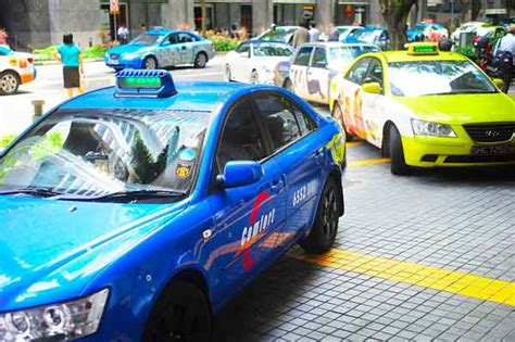 limo service app uber  threat  singapore taxi drivers