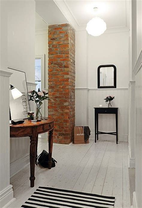 column style floor ls love the white plank floors and the exposed brick column
