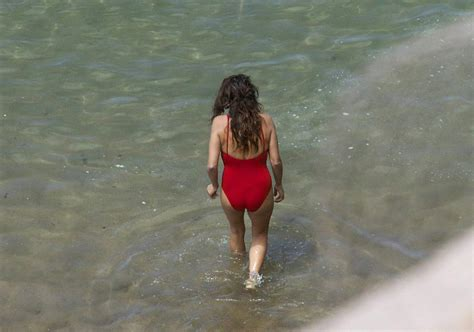 penelope cruz swimsuit penelope cruz in a red swimsuit at a beach in spain june