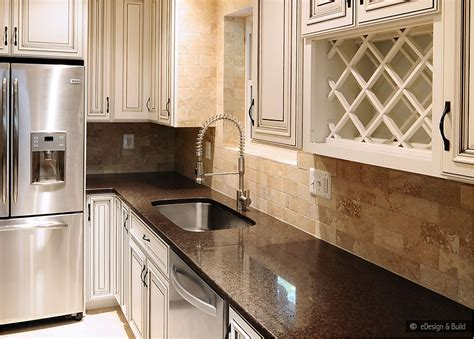 cream backsplash with white cabinets cream cabinets with back splashes brown countertop cream