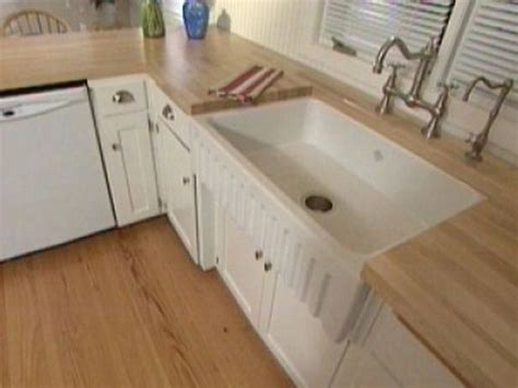 how to install a farmhouse sink in existing cabinets installing an apron front sink
