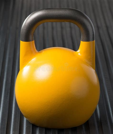 kettlebell yellow weight training gym mat competition lit rim silhouette floor