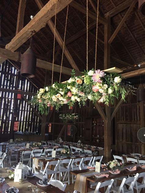 hanging arrangements heighten  impact   wedding