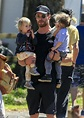 Chris Hemsworth carries twin sons Tristan and Sacha on ...