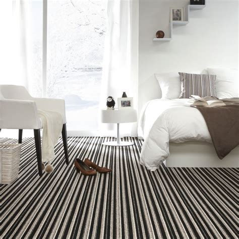 carpet for bedrooms modern bedroom with stylish bed and striped carpet 10996   bdedb40534596208803983f617335e24