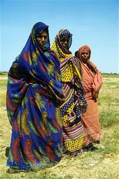 ugandan women wearing traditional gomesies image
