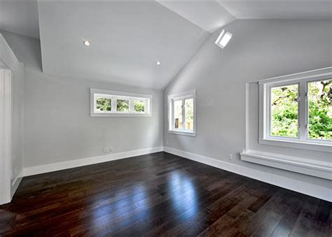 white floors grey walls dormer window captures sunlight and ephasizes high ceilings ideas for designing a room