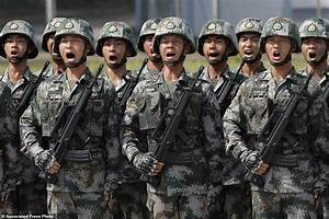 China flexes military muscle in Hong Kong on anniversary ...
