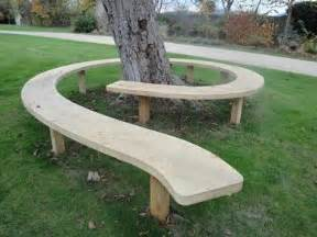 bench around the plum tree perhaps a swirl around each tree in back meeting to become a heart