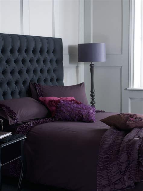 grey buttoned headboard  purple bedding home bedroom