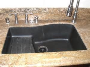 photos of kitchens with black sinks