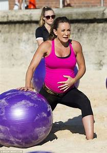 Michelle Bridges does sit-ups on a fitball at seven months ...