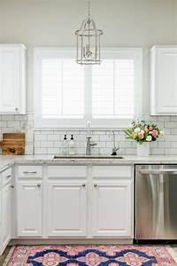 White granite kitchen countertops with white subway tile for Kitchen colors with white cabinets with framed wall art set of 3
