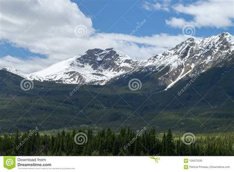 Snow Capped Mountains With Blue Cloudy Sky. Stock Image