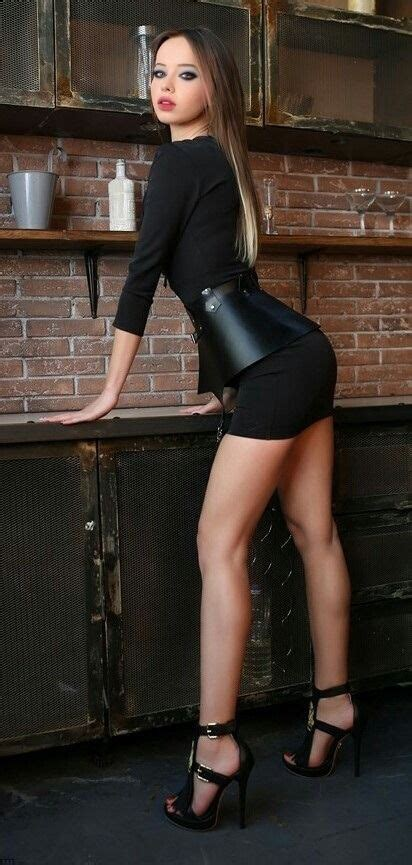 I  her tight mini dress and high heels  she has sexy long