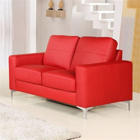 small red leather sofas  vibrant small living area