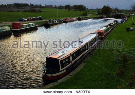 Canal Boat Navigation Lights by Moored Narrowboats In Evening Light On The Worcester And
