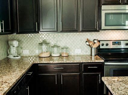 arabesque selene tile backsplash  espresso cabinets
