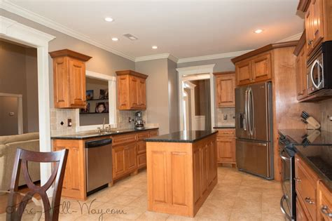 kitchen w maple cabinets with cherry stain and mocha