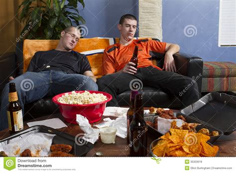 cuisine tv free two tired after sports on tv horizontal stock photo image of