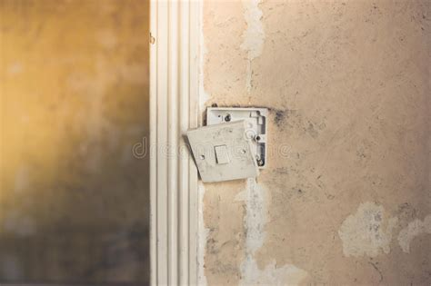broken light switch on wall stock