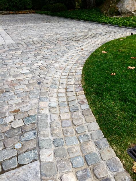 driveway swale reclaimed belgian porphyry cobblestone cubes create this useful and elegant swale cobblestone