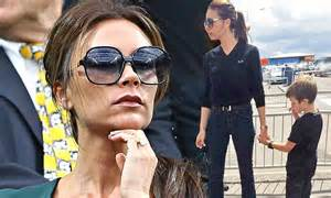 Victoria Beckham shows off her ultra thin pins in a pair ...