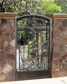 wrought iron garden gate through the garden gate