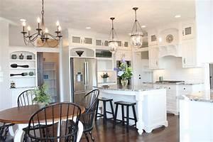 Pendant lighting over island kitchen farmhouse with bar