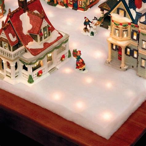 lighted snow blanket town light nativity