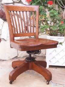 antique bankers oak rolling desk chair 1920s wood casters library industrial vintage finds