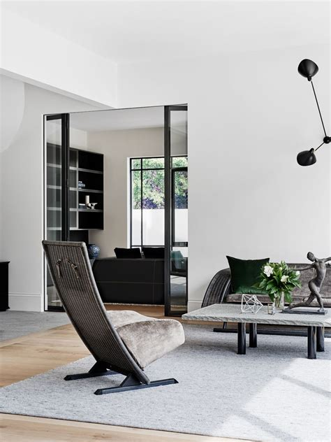 Living room in a Toorak home by Robson Rak Photo by