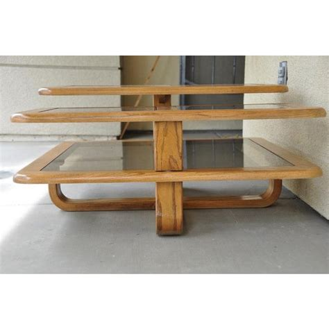 Depending on the decor of your space, you can pick from a variety of styles like modern, traditional, rustic and more. Mid-Century Modern 3-Tier Wood and Smoked Glass Coffee Table With Rotatable Arms   Chairish