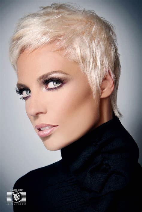 very short blonde hairstyle annie lenox or pink look
