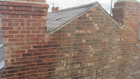 Replace bricks on a gable end at first floor height