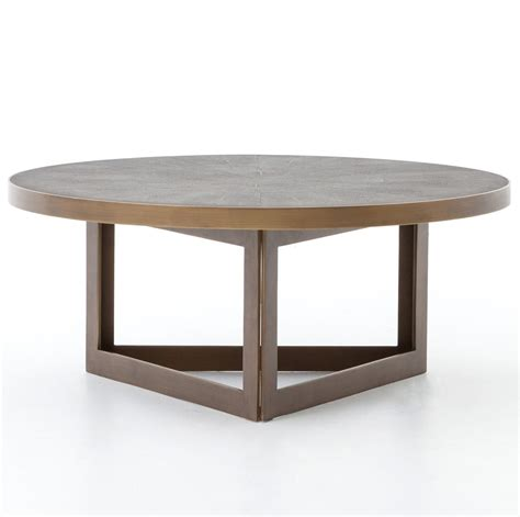 Many round coffee tables on our list put glass and drum style coffee table: Hollywood Modern Shagreen Round Coffee Table - Antiqued Brass   Zin Home