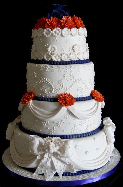 layer wedding cakes drapes bows  flowers cake