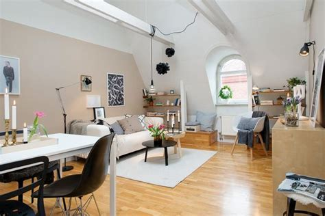 42 square meter attic apartment with subtle pops of color