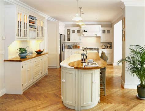 white kitchen island breakfast bar bespoke painted inframe kitchen with wooden oak and white quartz worktops narrow curved
